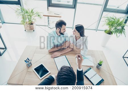 High Angle Top View Of Cheerful Married Couple, Getting A Car Key From A Car Dealer In The Showroom