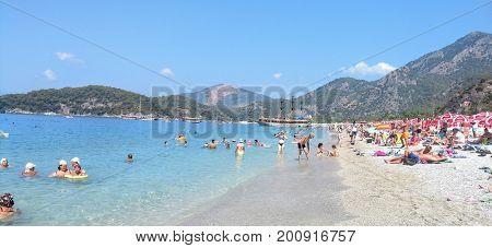 OLYUDENIS, TURKEY - AUGUST 09, 2017: Belcekiz Beach in the famous resort town of Oludeniz on the southern Mediterranean coast of Turkey