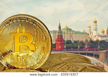 Photo Golden Bitcoins (new virtual money). Coins in the background of Moscow. Conceptual photo.