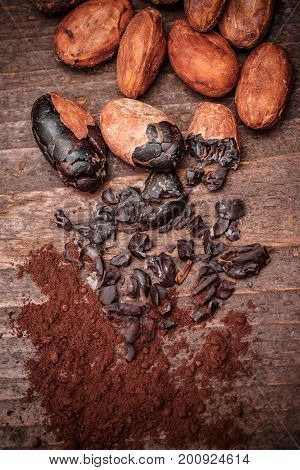 Roasted Cacao (cocoa) nibs on old wooden background