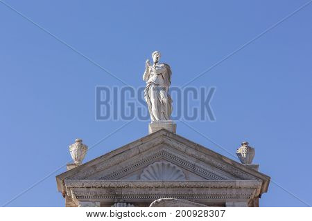 Just Statue present above the tympanum of the military arsenal of Venice to understand a historical concept and tourist attraction