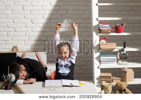Schoolgirl With Cheerful Face And Gestures And Her Sleepy Dad