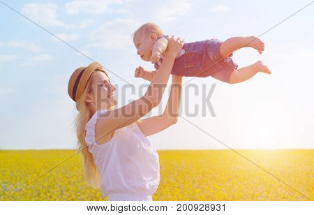 Young Happy Mother With Her Infant Son
