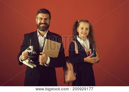 Kid And Dad Hold Microscope, Book And Stationery