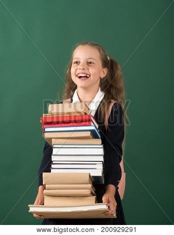 Girl In Classroom On Green Background. Schoolgirl With Cheerful Face