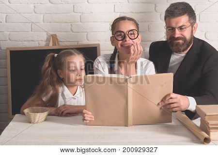 Kid, Elder Sister And Tutor In Glasses With Happy Faces