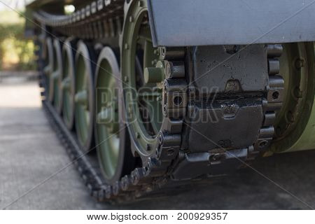 Tank Tracks. A Tank Of The Second World War.close Up View Of World War Tank Road Wheels And Tracks