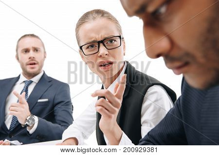 businesswoman quarreling at guilty businessman isolated on white