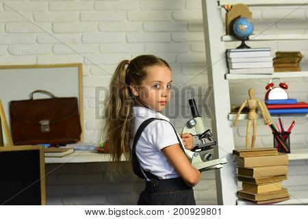 Kid Does Experiments. Back To School Concept. Girl With Ponytails