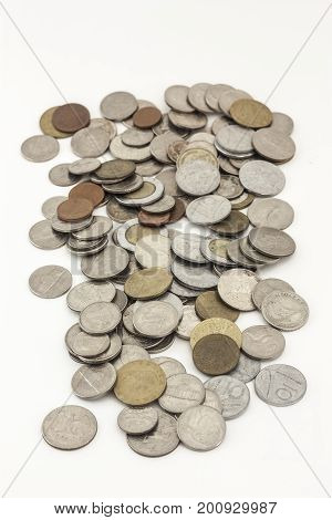 Mixed coins of various countries over white background to concept a business concept