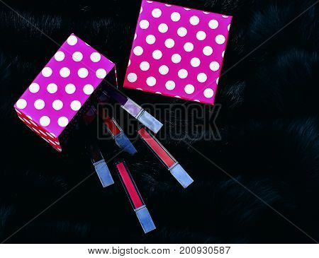 Lipsticks With Present Box On Fur Background