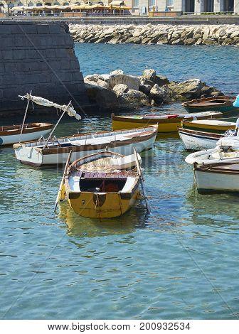Fishing boats moored in Borgo Marinari harbor of Megaride island. Naples. Campania Italy.