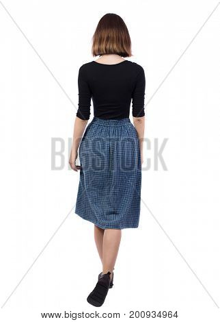back view of walking woman in dress.   beautiful girl in motion.  backside view of person.  Rear view people collection. Isolated over white background. The girl in the blue plaid skirt goes away.