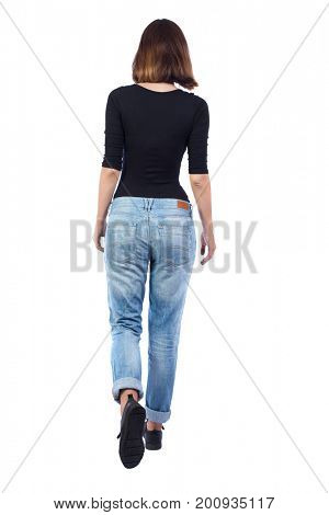 back view of walking woman. beautiful blonde girl in motion. backside view of person.  Rear view people collection. Isolated over white background. girl in jeans and a black T-shirt goes into distance
