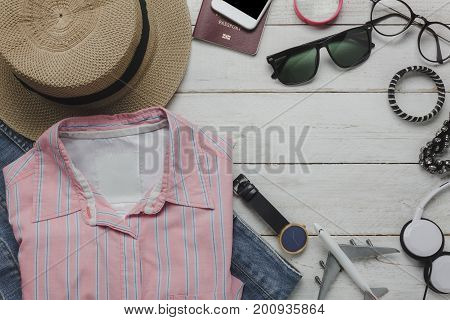Flat lay of clothing women to travel concept background.Different verity of object on modern table office desk.Items garment for teenage or young and guy to trip.Free space for design text and word.