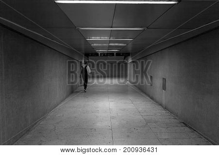 The tunnel leading from the train station to the city, daily passage for people who go to work, attend school or to run errands in the city.