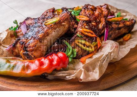 Appetizing Grilled Ribs Decorated With Hot Pepper. Horizontal Frame