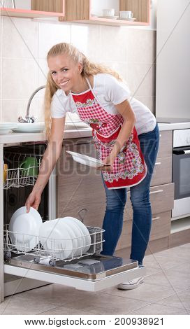 Woman Loading Dishwasher
