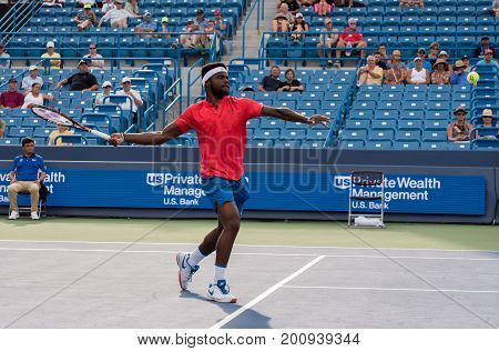 Mason Ohio - August 17 2017: Frances Tiafoe in a round of 16 match at the Western and Southern Open tennis tournament in Mason Ohio on August 17 2017.