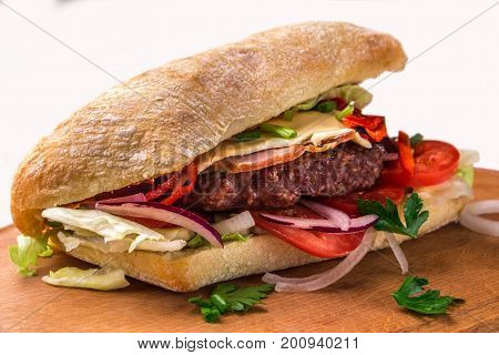 A Sandwich With Fried Chops, Herbs, Tomatoes, Peppers. Horizontal Frame