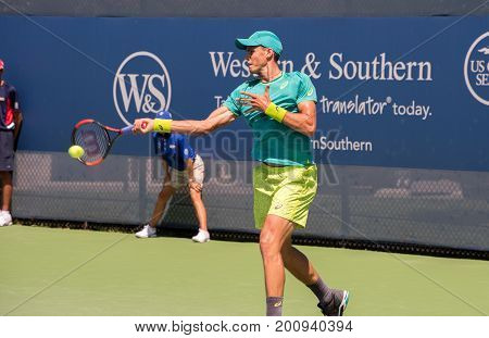 Mason Ohio - August 12 2017: Vasek Pospisil in a qualifying match at the Western and Southern Open tennis tournament in Mason Ohio on August 12 2017.