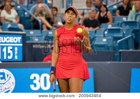 Mason Ohio - August 14 2017: Madison Keys in a first round match at the Western and Southern Open tennis tournament in Mason Ohio on August 14 2017.