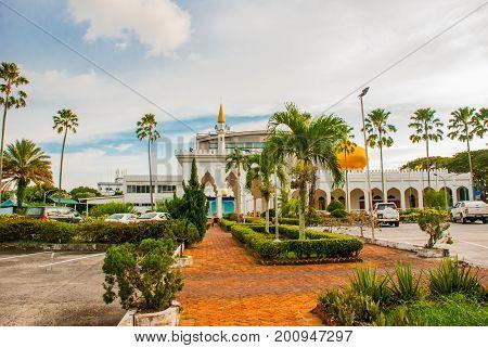 Masjid At-taqwa Mosque With Its Golden Dome And Palm Trees. Miri City, Borneo, Sarawak, Malaysia