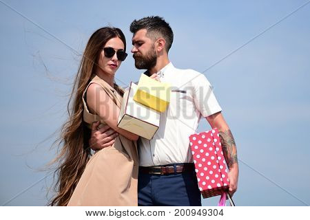 Couple Carries Colorful Packets And Box On Blue Background