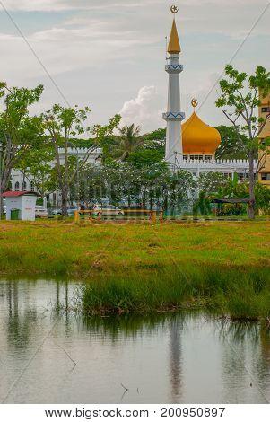 Masjid At-taqwa Mosque With Its Golden Dome At The Pond. Miri City, Borneo, Sarawak, Malaysia