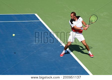Mason Ohio - August 13 2017: Ante Pavic in a qualifying match at the Western and Southern Open tennis tournament in Mason Ohio on August 13 2017.