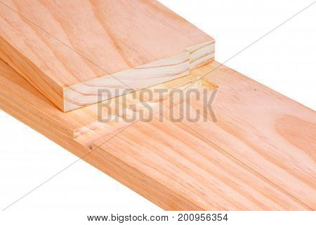 Close-up of two pine boards cut for a blind or stopped dado joint isolated against a white background