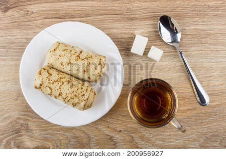 Pancakes With Stuffed, Sugar, Cup Of Tea And Teaspoon