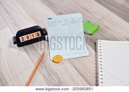 The empty book bank with 2018 new year cubes finance planning concept