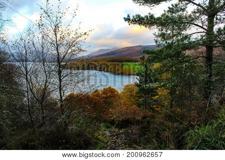 Magnificent sunset view of Loch Lomond in the Scottish Highlands during autumn.
