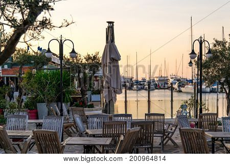 Sunset In Yacht Marina In Cesme With Cafes