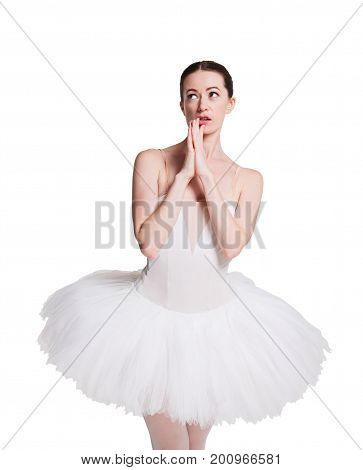 Scared and pensive ballerina portrait against white background, isolated. Professional dancer in tutu skirt afraids of something.