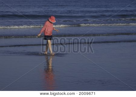 Girl In Pink At Shore