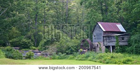 an old gristmill next to deep woods