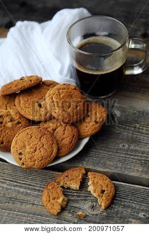 Homemade oatmeal cookies with raisins and coffee