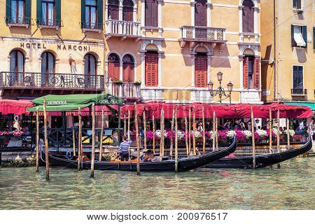 Venice Italy - May 18, 2017: Street with a pier for the gondolas on the Grand Canal. Gondola is the most attractive tourist transport in Venice.