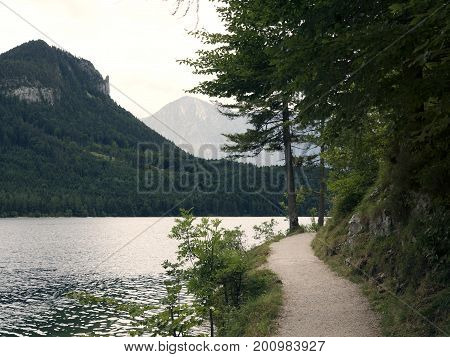 Hiking trail around mountain lake. Alpine massif, beautiful canyon in Austria. Alpine valley in summer, clear water. Healthy mountain nature, destination for hiking vacation. Salzburg landscape, Altausee.
