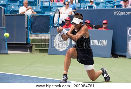 Mason Ohio - August 17 2017: Garbine Muguruza in a round of 16 match at the Western and Southern Open tennis tournament in Mason Ohio on August 17 2017.