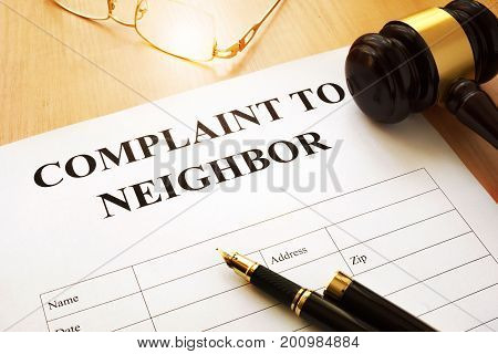 Complaint to neighbor form on a table.
