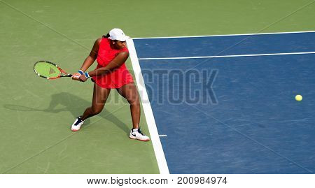Mason Ohio - August 14 2017: Taylor Townsend in a first round match at the Western and Southern Open tennis tournament in Mason Ohio on August 14 2017.