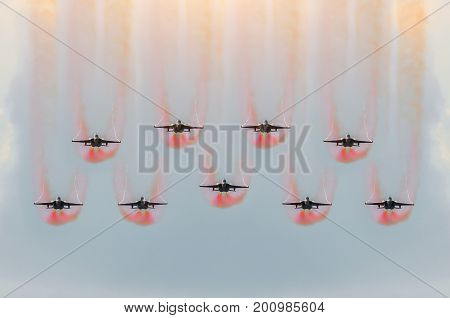 Nine Fighter Jets Fly Together With Red Smoke