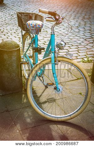 Cool vintage blue bycicle parked in central city hamburg.