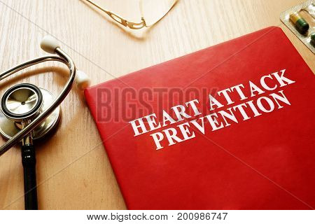 Heart Attack Prevention book on a table.
