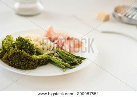 Parma ham, asparagus and arugula broccoli, healthy eating, snack diet