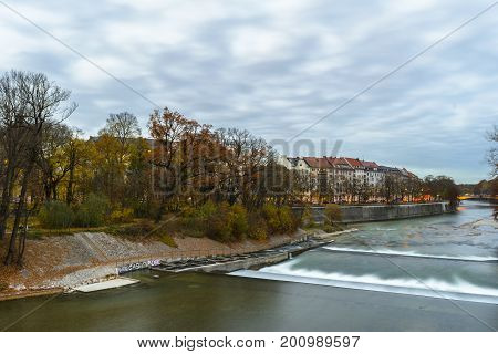 Autumn view on sunset with Isar river on November 06 2015 in Munich Bavaria Germany.