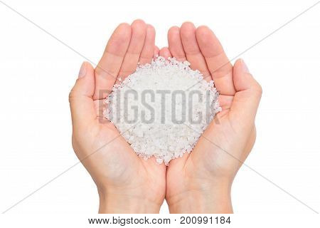 holding sea salt isolated on white background.